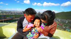 Mongolian family, Ulaanbaatar cityscape, Mongolia Stock Footage