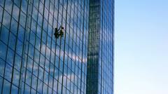 Skyscraper window glass cleaner Stock Footage