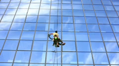 skyscraper window glass cleaner - stock footage