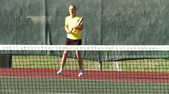 Tennis Game - girl playing tennis in slow motion Stock Footage