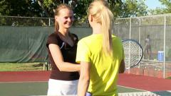 Friendly hug and handshake after tennis match Stock Footage