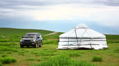 Jeep parked next to yurt Stock Footage