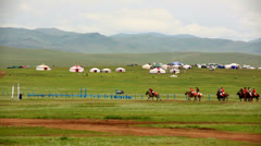 Men playing polo during Naadam Festival Stock Footage