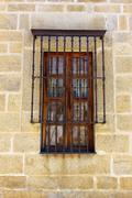 detail of an old window at alcantara, spain - stock photo