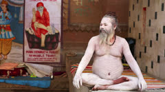 VARANASI, INDIA - MAY 2013: Naked Sadhu posing Stock Footage