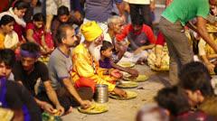 VARANASI, INDIA - MAY 2013: people eating free food at street - stock footage