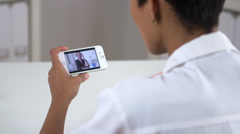 Senior patient video chatting with doctor on iphone - stock footage