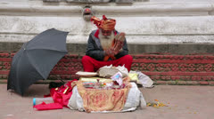 KATHMANDU, NEPAL - JUNE 2013: Senior man chanting in street Stock Footage