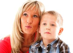 Mature mother with child 6 years boy isolated Stock Photos
