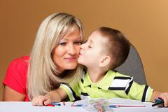 Stock Photo of mother and son drawing together
