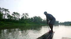 Stock Video Footage of CHITWAN, NEPAL - JUNE 2013: traditional boat and boatman