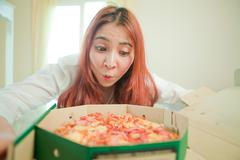 Stock Photo of young woman with pizza