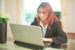 business young woman with laptop - stock photo