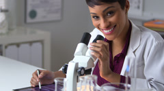Happy doctor smiling at desk - stock footage