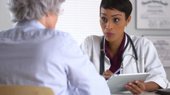 Doctor giving consultation to patient - stock footage