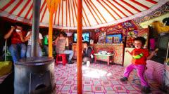 MONGOLIA - JULY 2013: Mongolian family inside yurt Stock Footage