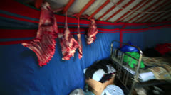 MONGOLIA - JUNE 2013: mongolian people drying Meet inside ger camp Stock Footage