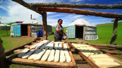 MONGOLIA - JULY 2013: Mongolian woman preparing food Stock Footage