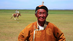 MONGOLIA - JULY 2013: Mongolian man with traditional clothes - stock footage