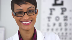 Pretty optometrist smiling at camera - stock footage
