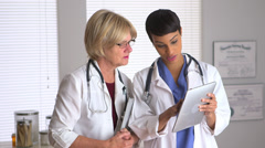 Two doctors talking with tablet Stock Footage