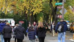 Autumn foliage in New York City people crossing street Stock Footage