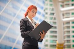 business woman with document - stock photo
