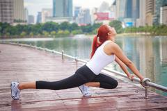 Stock Photo of young woman doing stretching exercise