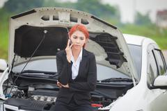Woman with car broke down Stock Photos