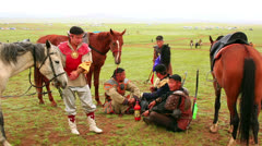 ULAANBAATAR, MONGOLIA - JULY 2013: Naadam Festival Horse Archery Crew Stock Footage