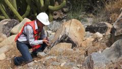 Geologist Man Rock Sample Stock Footage