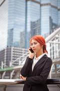 Woman calling on the phone Stock Photos