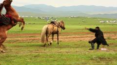 ULAANBAATAR, MONGOLIA - JULY 2013: Mongolian Medieval Warrior Shows Stock Footage