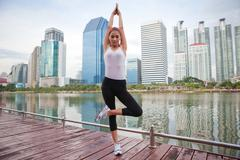 young woman doing stretching exercise - stock photo