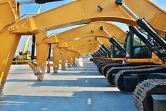 Caterpillars, Yellow heavy construction work vehicles, parking Stock Photos