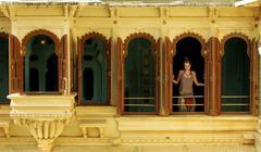 Female tourist at Udaipur Palace - stock photo