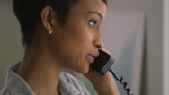 Stock Video Footage of Close up of Black business woman making phone call