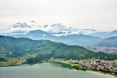 View of Pokhara lake with Annapurna in background, Nepal - stock photo