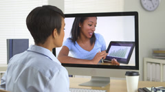 Two African American business women chatting over internet - stock footage