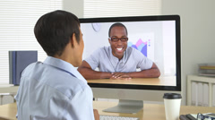 Two African American business people chatting over internet Stock Footage