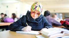 Muslim girl studying in library Stock Photos
