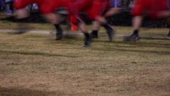 Slow motion of legs of football players running onto field Stock Footage
