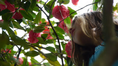 Young Girl Among Many Flowers Stock Footage
