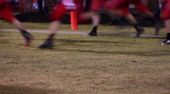 Football players taking field Stock Footage