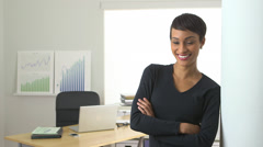 Black business woman standing in doorway smiling - stock footage