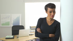 African American business woman standing in doorway thinking - stock footage