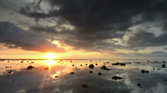 Sunset on the island of Gili Trawangan, on background volcano island of Bali Stock Footage