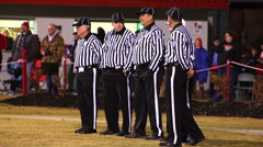 Football referee's removing hats for national anthem Stock Footage