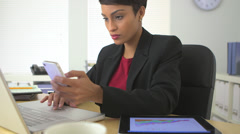 African American business woman using cell phone and tablet computer - stock footage
