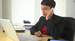 African American business woman using mobile phone and tablet computer - stock footage